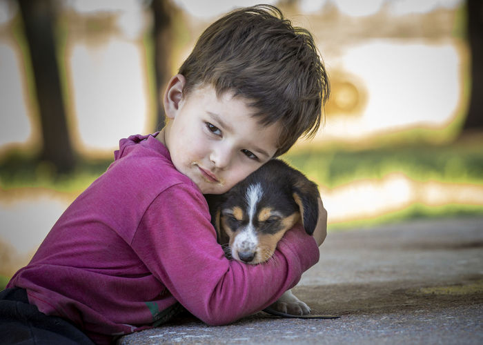 One Animal Pets Domestic Domestic Animals Mammal Child Dog Canine Portrait Childhood Boys One Person Focus On Foreground Innocence Pet Owner Human Connection