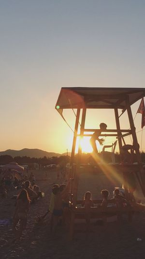 sunset rage Sunset Men Real People Leisure Activity Silhouette Sunlight Sun Sky Lifestyles Clear Sky Outdoors Standing Large Group Of People Full Length Togetherness Nature Women Bonding Day People Childhood Children Kids Play Playing