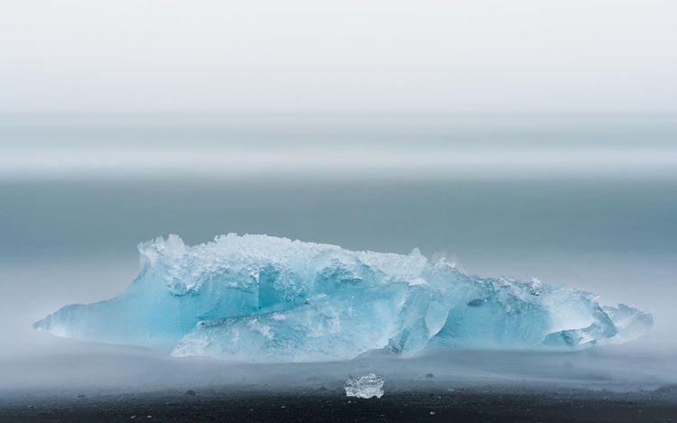 Beauty In Nature Cold Temperature Frozen Frozen Glacier Ice Iceland Idyllic Jökulsárlón Majestic Nature No People Non-urban Scene Outdoors Scenics Season  Sky Ice Calm Tranquility Water Weather White Color Palette Winter Color Palette Mission Finalists