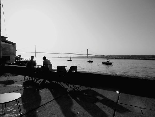 Water Nautical Vessel Transportation River Bridge - Man Made Structure Boat Clear Sky Engineering Suspension Bridge Travel Destinations Sailboat Day Tourism Riverbank Sun Cable-stayed Bridge Bridge Outdoors TakeoverContrast Riverscape Riverside Tranquility Tranquil Scene Monochrome Photography People And Places