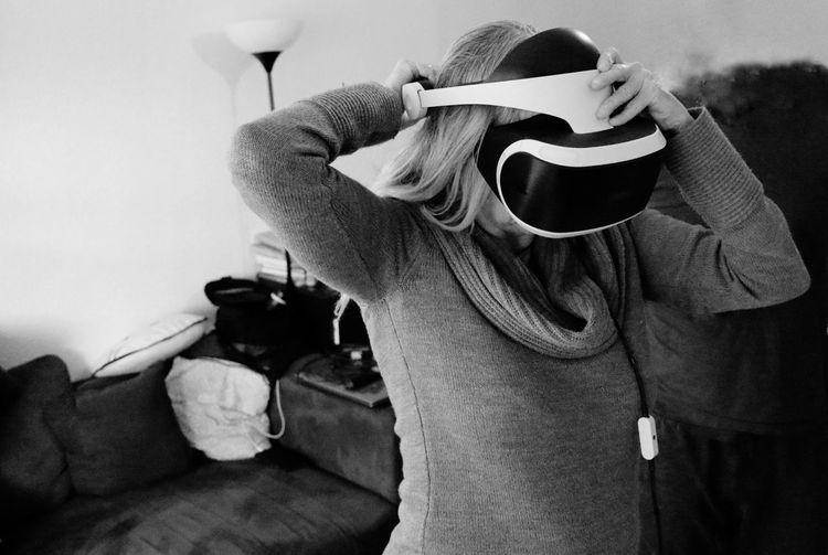 Close-up of mature man using virtual reality simulator at home