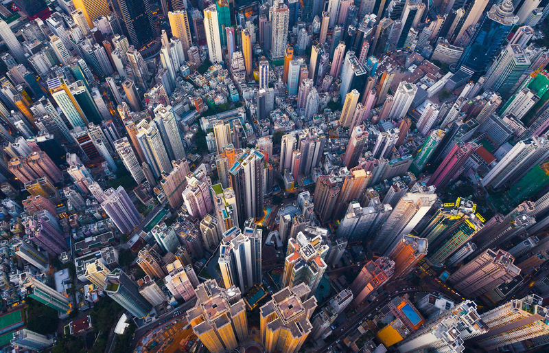 Aerial view of Hong Kong Downtown. Financial district and business centers in smart city in Asia. Top view of skyscraper and high-rise buildings. City Cityscape Downtown Drone  Financial District  Hong Kong Skyscrapers Travel Abundance Aerial View Architecture Backgrounds Building Buildings City Cityscape Day Directly Above Full Frame High Angle View High Rise Building Large Group Of Objects Modern Motion No People Office Building Exterior Outdoors Skyscraper