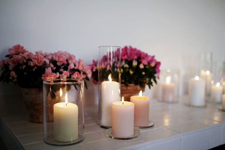 Beauty In Nature Bouquet Burning Candle Decoration Fire Flame Flower Flower Arrangement Flowering Plant Freshness Illuminated Indoors  Nature No People Plant Tea Light