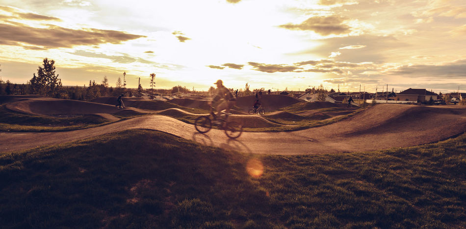 Extreme Sports - Sunset Cycle Track Excercising Animal Themes Beauty In Nature Bicycle Bicycle Track Cloud - Sky Cycle Track Cycling Day Extreme Sports Landscape Mammal Nature No People Outdoors Scenics Sky Sports Sunset Track Urban Summer Sports