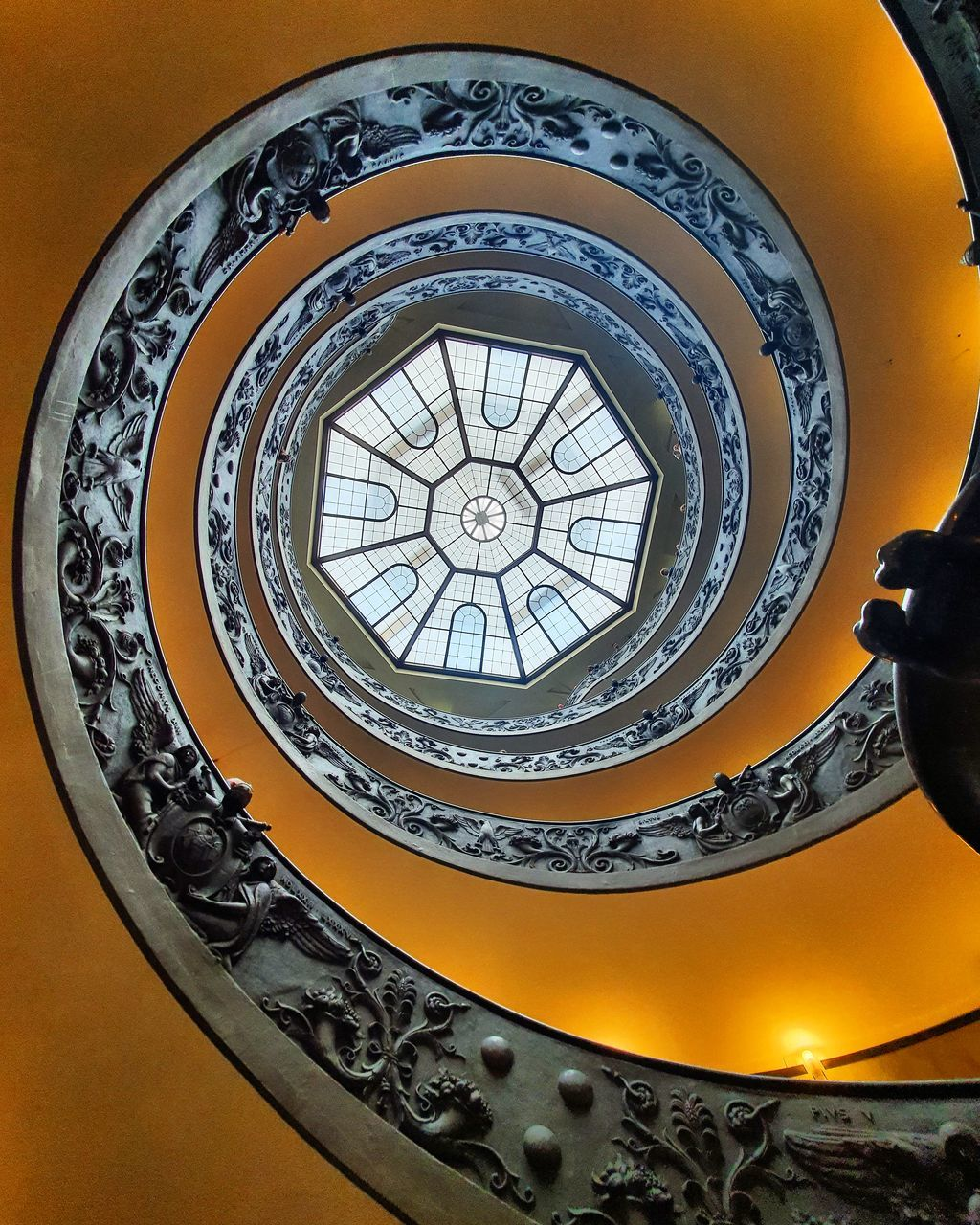LOW ANGLE VIEW OF SPIRAL STAIRCASE IN CEILING