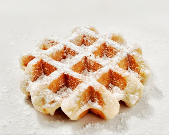 Belgian waffle dusted in powdered sugar Belgan Waffles Waffle Food And Drink Food Sweet Food Powdered Sugar Sugar Freshness Indoors  Still Life No People Indulgence Shape High Angle View Baked Star Shape Ready-to-eat Dessert Close-up Sweet Studio Shot Cookie