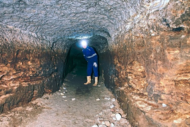 The old sandstone water tunnel.  sandstone tunnel moistened walls. dry channel carved in underground