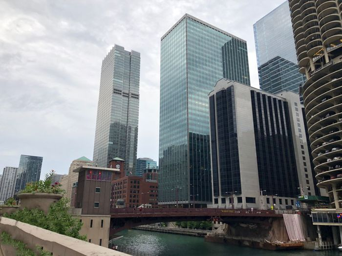 Chicago river walk in city Chicago Chicago River Chicago Skyline Chicago Architecture Overcast No People Low Angle View Financial District  Landscape Skyscraper Modern Architecture Tower Outdoors Cityscape Water Copy Space Tall - High Bridge Business Finance And Industry Office Building Exterior City Built Structure High Looking Up