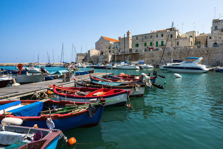 Colorful small harbor of Gionazzo, Apulia, Italy Apúlia Puglia Architecture Building Building Exterior Built Structure Canal City Clear Sky Day Gargano Giovinazzo Harbor Italy Mode Of Transportation Moored Nature Nautical Vessel No People Outdoors Port Sailboat Sea Sky Transportation Water Waterfront Wooden Post
