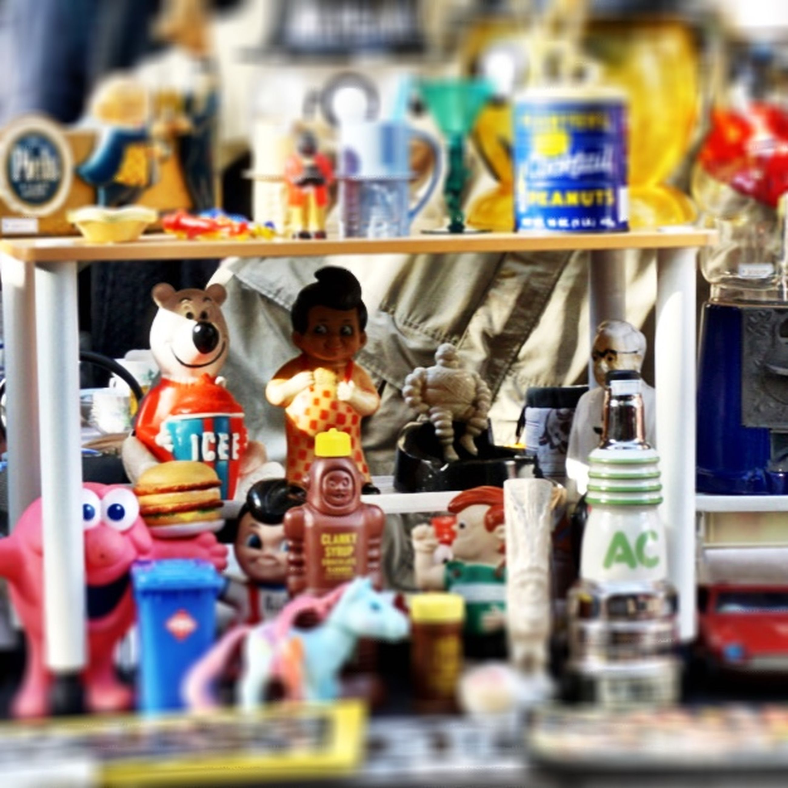 for sale, retail, indoors, store, variation, choice, shop, selective focus, focus on foreground, display, human representation, collection, large group of objects, market stall, sale, market, shelf, retail display, abundance, arrangement