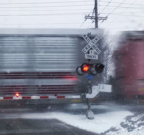 Transportation Railway Signal Rail Transportation No People Outdoors Illuminated Grey Color Crossing Sign Roadblock Copy Space Railroad Lights Railroad Crossing Moving Train Railroad Crossing Sign Cargo Train Train Train Tracks Railroad Track Train In Motion Winter Feeling Obstacles Grey Train - Vehicle Road Sign Red Light