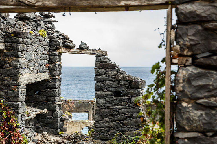 Madeira Island São Jorge Architecture Beauty In Nature Built Structure Day Horizon Over Water Nature No People Outdoors Rock - Object Ruined Building Ruins Architecture Scenics Sea Sky Water
