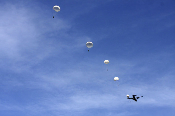 Adventure Air Vehicle Airplane Alighting Army Blue Flying Landing Troops Low Angle View Military Exercise NATO Parachute Parachutes Parachutes In Formation Paratroopers Sky Soldiers