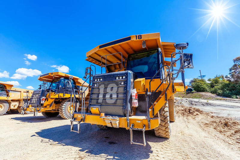 Construction vehicles on ground during sunny day