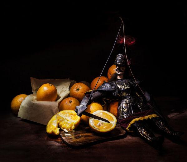 Objects Pupo Siciliano Sicily, Italy Black Background Citrus Fruit Food Food And Drink Freshness Fruit Healthy Eating Indoors  Light Painting Photography. Orange Puppet Sitting Snack Studio Shot