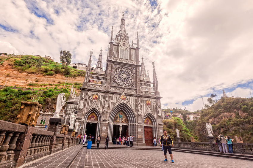 Ipiales, Colombia - 11 September 2016: Las Lajas Colombian Catholic Church, Built Between 1916 And 1948 Is A Popular Destination For Religious Believers From All Part Of Latin America, Topographically The Most Beautiful In The World, South America Adult Architecture Catholic Church City Clock Cloud - Sky Colombia Cultures Day Faith Large Group Of People Las Lajas Las Lajas Cathedral Outdoors People Religious  Sky South America Sunday Tourism Tourist Travel Travel Destinations Vacations