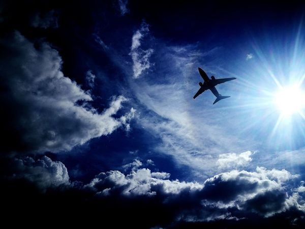 Flying Sky Cloud - Sky Low Angle View Mid-air Transportation Airplane Air Vehicle Blue Outdoors Day No People Milky Way Astronomy