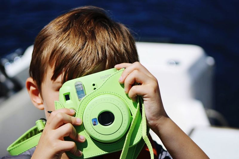 The Photographer Exploring Outdoors One Person Real People Child Childhood Headshot Leisure Activity The Portraitist - 2018 EyeEm Awards Portrait Focus On Foreground Day Photography Themes Boys Photographing Innocence Obscured Face Lifestyles