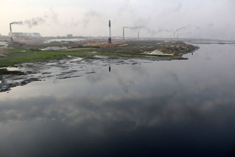 Air Pollution Brick Field Brickfield Industry Nature No People Outdoors Pollution River Sky Smoke Smoke - Physical Structure Water Water Pollution