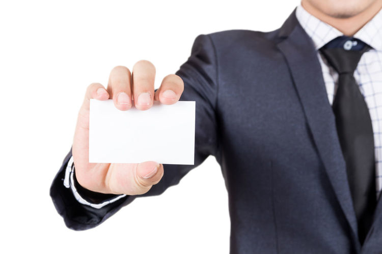 Businessman holding white business card isolated on white background Blank Business Business Person Businessman Communication Copy Space Finger Hand Holding Human Arm Human Body Part Human Hand Males  Marketing Men Message One Person Showing Studio Shot Technology Thumb White Background