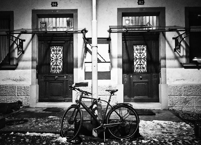"""blackandwithe"""" Streetphoto_bw Streetphotography Cityphotography Urbanphotography Snow Photography Photooftheday Architecture Building Exterior Built Structure Bicycle Window Day House"""