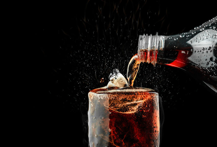 Pour soft drink in glass with ice splash on dark background. Studio Shot Black Background Drink Refreshment Motion Splashing Close-up Glass Food And Drink Water No People Copy Space Drinking Glass Cold Temperature Pouring Alcohol Bottle Cola Cocacola Coca Cola Softdrink Softdrinks Soft Drink Beverage Beverages