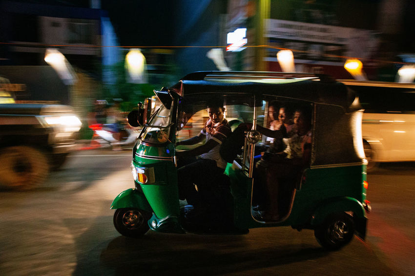 The streets were bustling and writhing with energy in Galle as Sri Lankans celebrated Vesak, the day of Buddah. Shooting from a Tuk Tuk in low light is extremely difficult in ever changing circumstances with light shifting every time traffic moves. Sri Lanka The Street Photographer - 2018 EyeEm Awards The Traveler - 2018 EyeEm Awards TukTuk Blurred Motion City Life Land Vehicle Long Exposure Mode Of Transportation Motor Vehicle Street Photography Transportation Travel Vesak