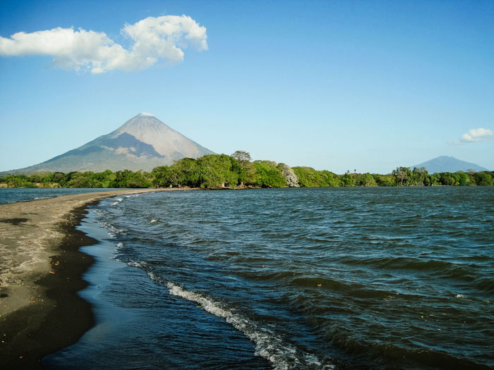 Ometepe Island in Nicaragua, vulcanoe with blue sky and clouds in the background Latin America Travel Beauty In Nature Clouds Island With Beach Landscape Mountain Nature No People Ometepe Island Outdoors Scenic View Scenics Sea Tranquil Scene Tranquility Vacation Vulcano Water Waterfront