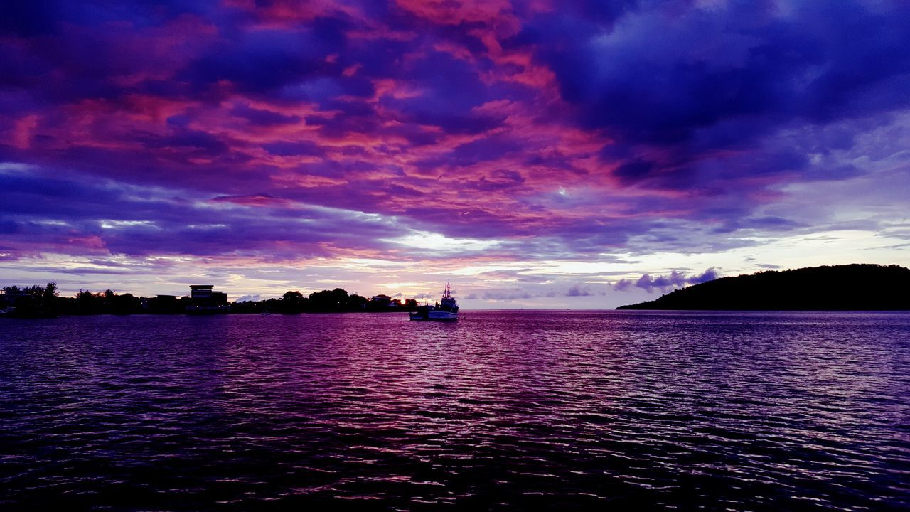 water, sunset, sky, cloud - sky, beauty in nature, scenics, tranquil scene, nature, tranquility, sea, outdoors, no people, waterfront, nautical vessel, rippled, horizon over water, architecture, day