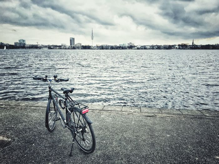 Hamburg - A City For Cyclists Hamburg Bicycle Sky Cloud - Sky Beach Water Day Stories From The City Outdoors Tranquility Storm Cloud Land Vehicle Nature Stories From The City