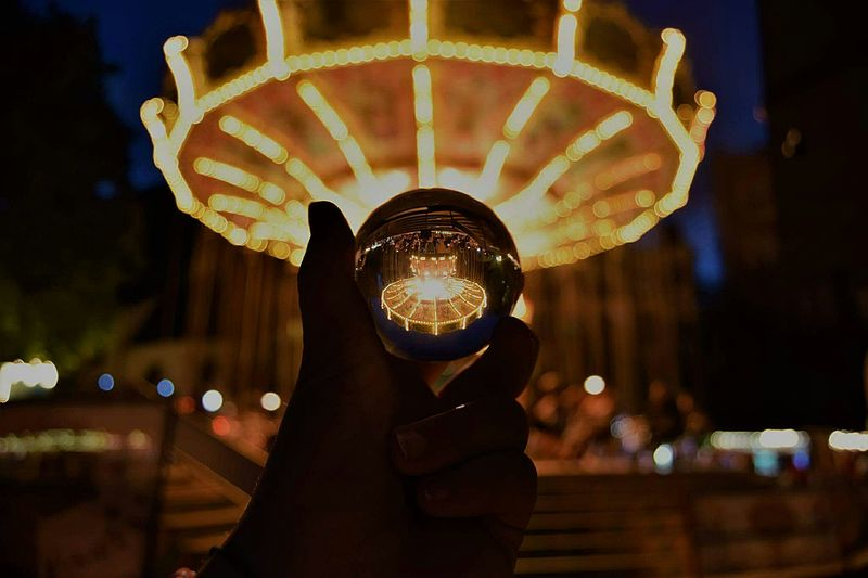 Night Arts Culture And Entertainment Adult Ferris Wheel Amusement Park Photographing Nightlife Illuminated Amusement Park Ride People Human Body Part Adults Only One Person One Man Only Outdoors Human Hand Glaskugel Lensball Art Sky Eyeball PhotographyFrankfurt