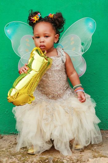 Portrait of cute girl wearing fairy costume