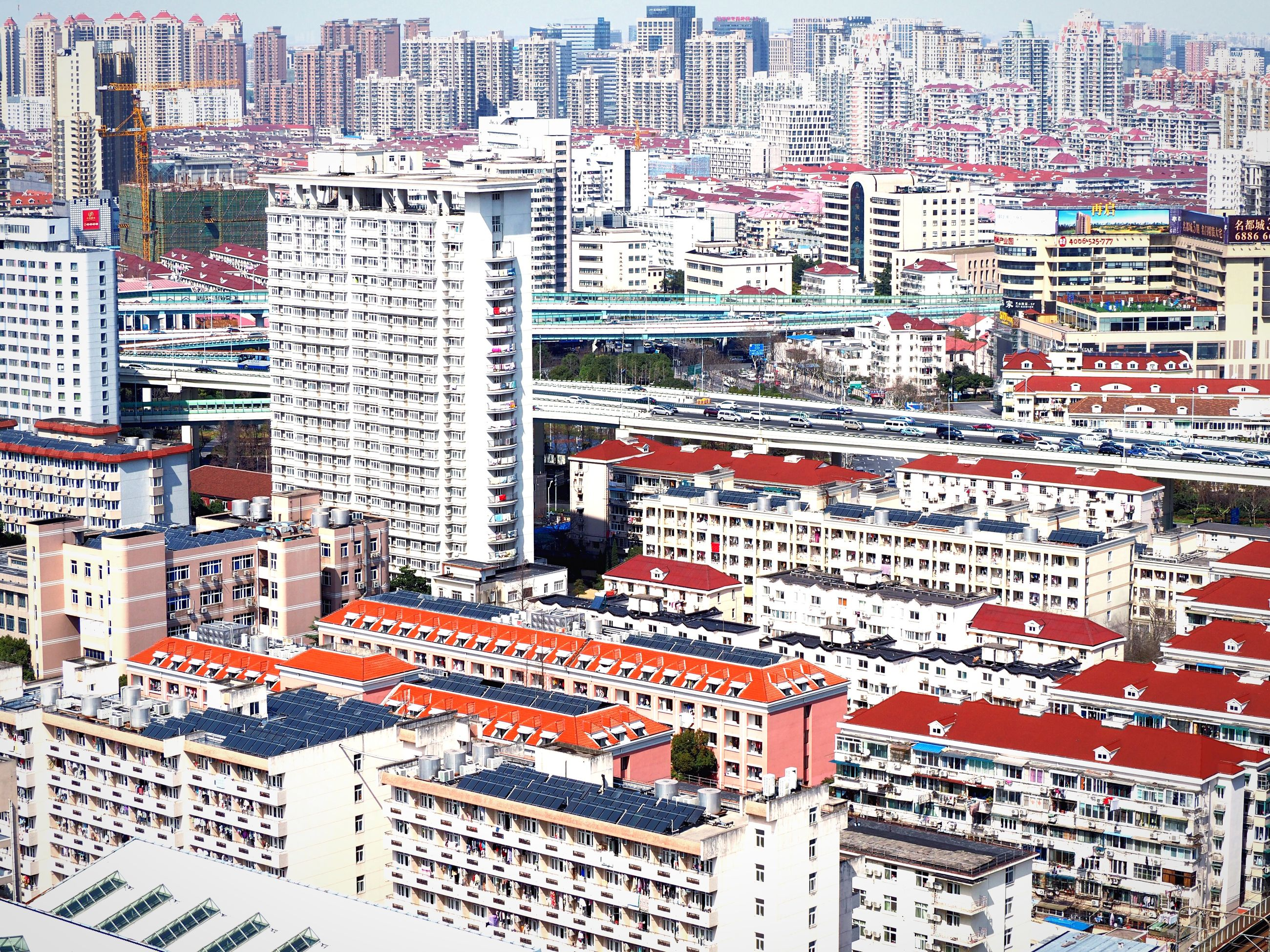 building exterior, architecture, built structure, city, residential structure, crowded, high angle view, full frame, residential building, backgrounds, cityscape, day, roof, residential district, outdoors, building, no people, city life, travel destinations, multi colored