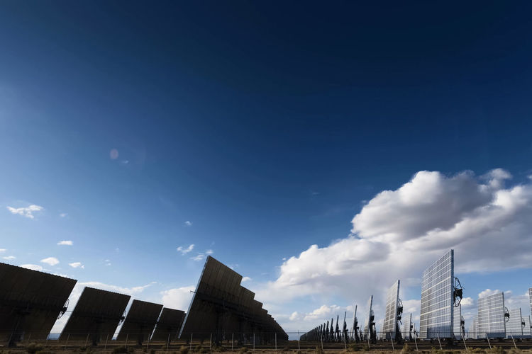 solar panels Sky Built Structure Building Exterior Architecture Cloud - Sky Low Angle View Nature City Building Day Blue No People Sunlight Outdoors Office Building Exterior Barrier Modern High Section Travel Destinations City Life Solar Panels