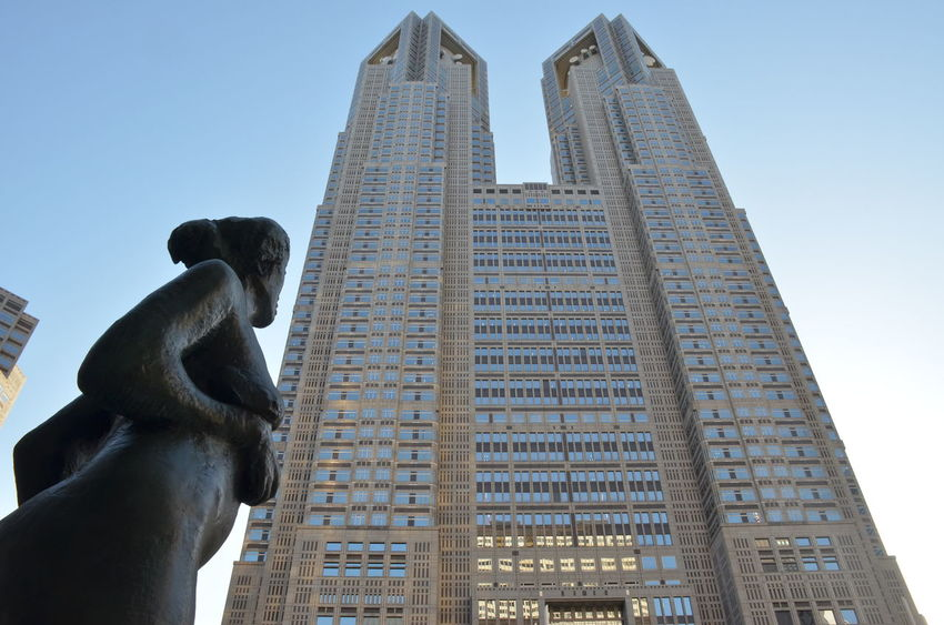 The imposing Tokyo Metropolitan Building. Free way to get a birds eye view of Shinjuku and beyond. Architecture Art And Craft Building Exterior Low Angle View Modern Outdoors Sculpture Shinjuku Skyscraper Statue Tokyo Tokyo Metropolitan Government Building Tokyo,Japan