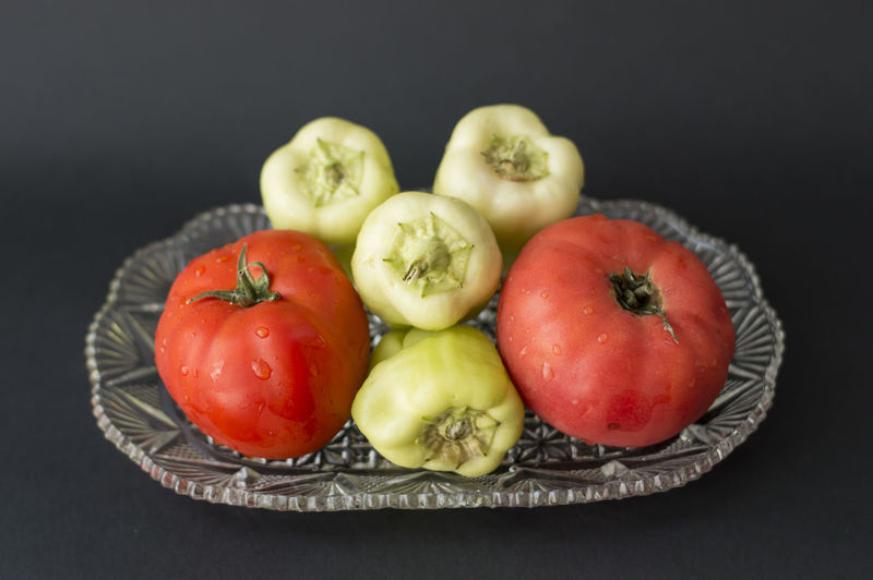 Close-up of tomatoes and fruits in plate