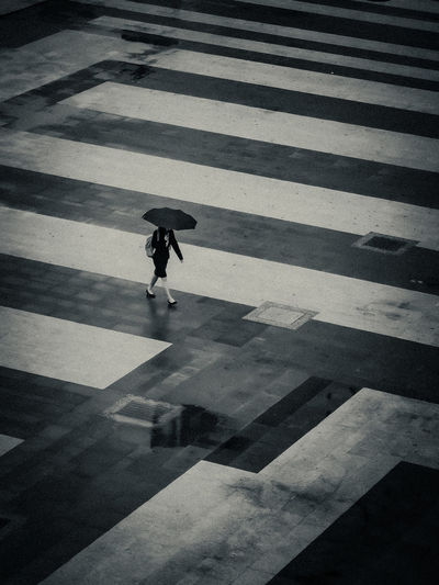 High angle view of a woman crossing on road