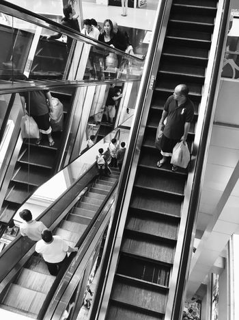 B+W Street Photography Blackandwhite Cross Real People Escalator Steps Steps And Staircases Men Staircase Built Structure Railing Large Group Of People Lifestyles High Angle View Architecture Leisure Activity Women Indoors  City Day People Adult Adults Only Sommergefühle
