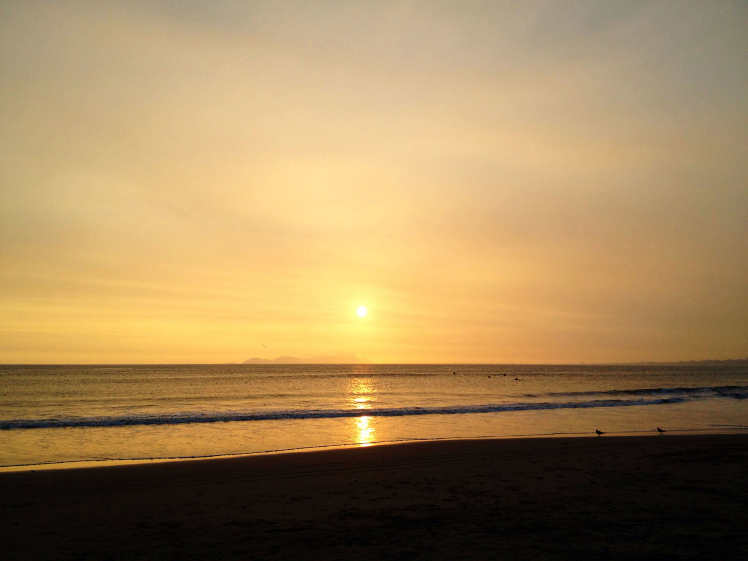 sea, horizon over water, beach, sunset, water, scenics, shore, tranquil scene, beauty in nature, tranquility, sun, sky, idyllic, orange color, nature, sand, wave, coastline, sunlight, reflection