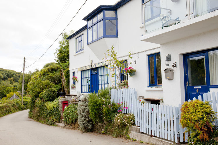 Helford River Home Quiet Road Blue Building Building Exterior Bush Fence Helford House Outdoors Quiet Place  Row House Street Village Village Life White