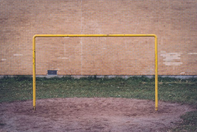 Soccer goal post against wall on field