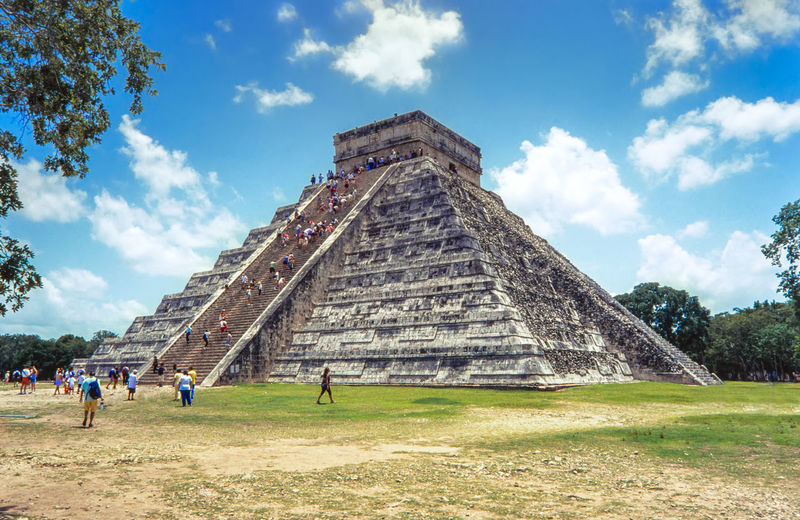 People At Chichen Itza Against Sky