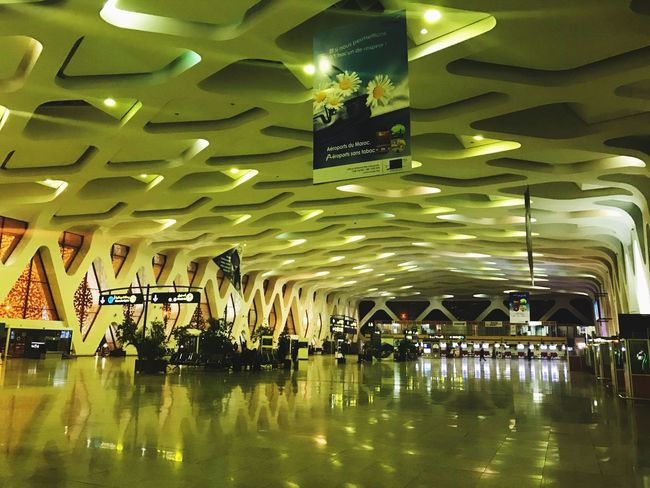 Morocco Lighting Equipment Illuminated Indoors  Ceiling Transportation Reflection Architecture Travel Airport Incidental People Built Structure Airport Terminal Communication Sign Real People Night Text Modern Light