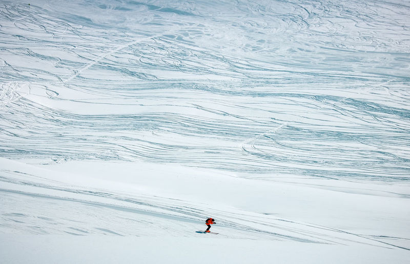 High angle view of person skiing on snowcapped mountain