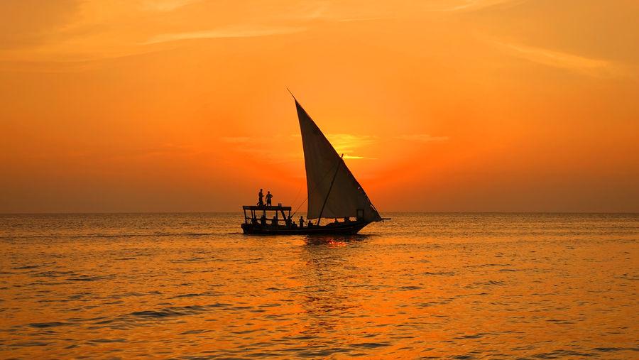 Indian Ocean Sansibar Sonnenuntergang Strand Urlaub Zanzibar Beach Boat Indischer Ozean Orange Color Sailboat Sea Segelboot Sunset Vacation Water EyeEmNewHere