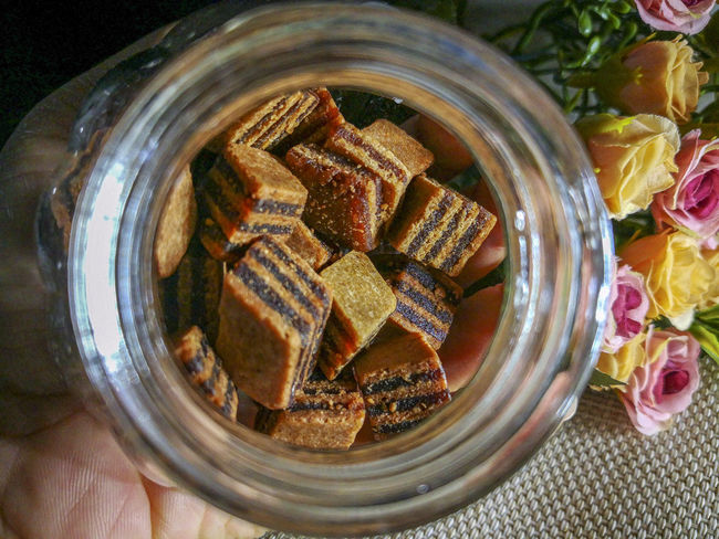 Closeup and selective focus a Sarawak Layer Cake or local called Kek Lapis with minimal lighting and flare serve on the top of table. Sarawakmalaysia Layer Cakes Food And Drink Directly Above Freshness Indoors  Food Close-up Jar Human Hand Table Container High Angle View Still Life Hand Healthy Eating Glass - Material Sweet Food Human Body Part Wellbeing Indulgence Sweet Temptation