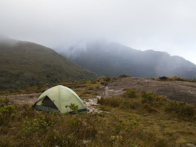 camping tent on a cloudy and rainy day Camping Hiking Adventure Beauty In Nature Camping Tent Day Landscape Mountain Mountain Range Nature No People Outdoors Sky Tent Tent Camping Tents