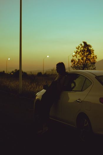 wait for me. Leaning Girl Sunset Tones Tree Sitting Car Land Vehicle Sky Driver Windshield
