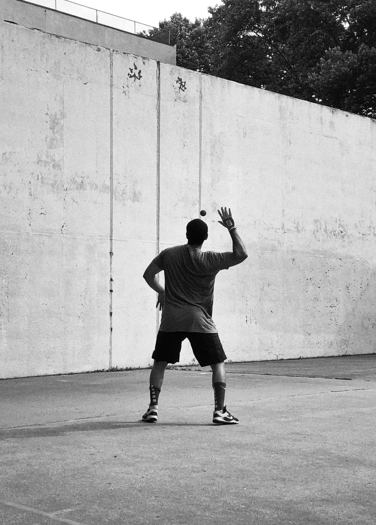 Rear view of man playing in handball court