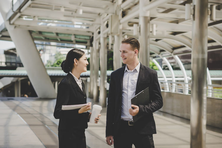 Business people talking while standing outdoors